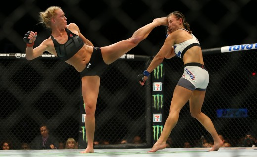 LAS VEGAS, NV - MARCH 5:  UFC bantamweight champion Holly Holm (L) kicks Miesha Tate takes during UFC 196 at the MGM Grand Garden Arena on March 5, 2016 in Las Vegas, Nevada. (Photo by Rey Del Rio/Getty Images)
