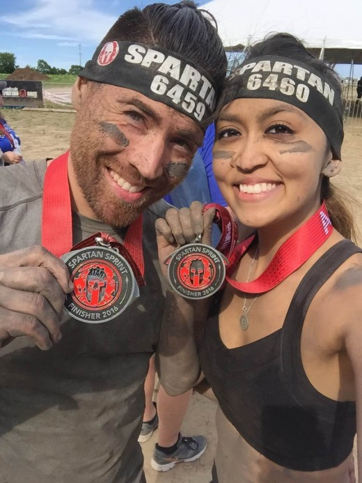 Hola Sports writer Nick Cunningham and fiancé, Alexandra Jaimes show their finishing medals for the Spartan Sprint Race, in Richmond, IL.