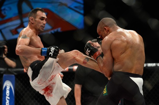LAS VEGAS, NV - DECEMBER 11: (L-R) Tony Ferguson kicks Edson Barboza in their lightweight bout during the TUF Finale event inside The Chelsea at The Cosmopolitan of Las Vegas on December 11, 2015 in Las Vegas, Nevada.  (Photo by Brandon Magnus/Zuffa LLC/Zuffa LLC via Getty Images)