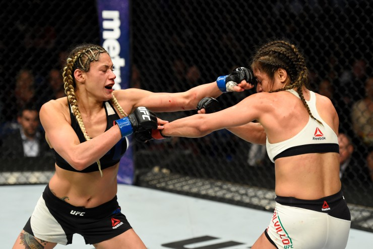 BUFFALO, NY - APRIL 08:  Pearl Gonzalez (L) lands a punch on Cynthia Calvillo in their women's strawweight bout during the UFC 210 event at KeyBank Center on April 8, 2017 in Buffalo, New York.  (Photo by Josh Hedges/Zuffa LLC/Zuffa LLC via Getty Images)