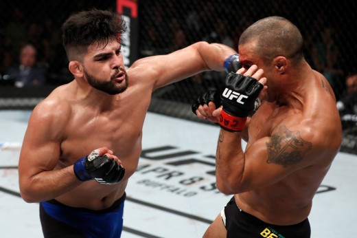 FORTALEZA, BRAZIL - MARCH 11:  Kelvin Gastelum punches Vitor Belfort of Brazil in their middleweight bout during the UFC Fight Night event at CFO - Centro de Formaco Olimpica on March 11, 2017 in Fortaleza, Brazil. (Photo by Buda Mendes/Zuffa LLC/Zuffa LLC via Getty Images)