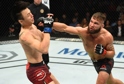 ST. LOUIS, MO - JANUARY 14:  (R-L) Jeremy Stephens punches Dooho Choi of South Korea in their featherweight bout during the UFC Fight Night event inside the Scottrade Center on January 14, 2018 in St. Louis, Missouri. (Photo by Josh Hedges/Zuffa LLC/Zuffa LLC via Getty Images)